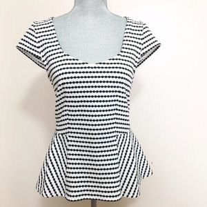 Anthropologie Tops - Anthropologie black and white peplum top
