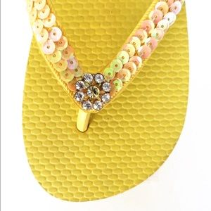 329d39fb84edf nomad Shoes - Yellow flip flops with sequins and crystal flower