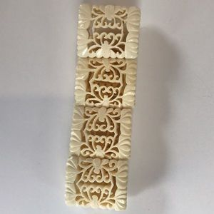 Jewelry - NWOT Ivory Colored laser cut Bracelet