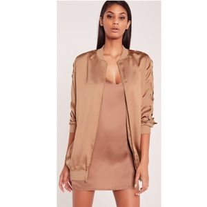 Carli Bybel satin rose gold bomber jacket
