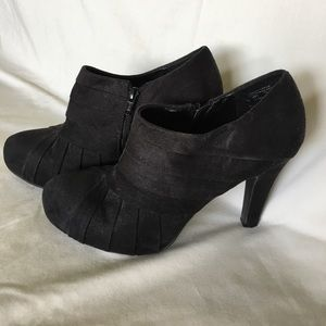 Black suede heeled booties.