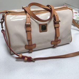 Handbags - Dooney and Bourke ecru patent leather handbag