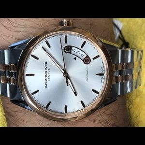Raymond Weil Other - Two tone men's stainless steel mechanical watch.