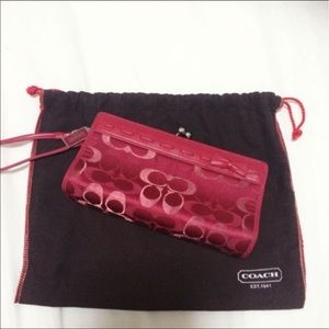 Authentic red Coach logo clutch with strap