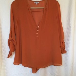 $10 Rust silky button blouse