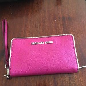 Adorable hot pink Michael Kors phone wallet