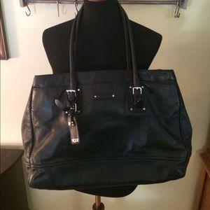 Tumi Handbags - Tumi black leather tote loaded with pockets
