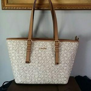 Calvin Klein Handbags - Calvin Klein light beige shoulder bag purse