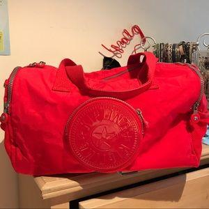 Small red Kipling duffel bag