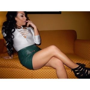 Green faux leather mini skirt with zippers