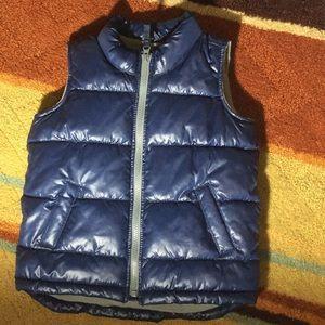 Blue puffer jacket vest