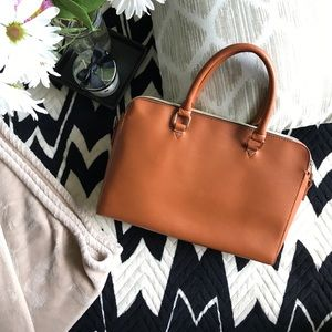 Cognac leather-inspired handbag
