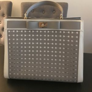 Light gray Kate Spade bow top handle satchel