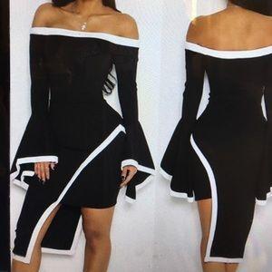 Dresses & Skirts - Asymmetric black dress trimmed in white
