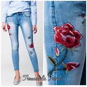 Rose Embroidered Distressed Denim Jeans