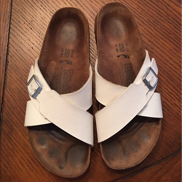 4c6c8f23c819c7 Birkenstock Shoes - Birki s EUC. Size 9. White cross strap sandal