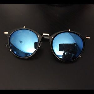 Black sunnies with blue lenses