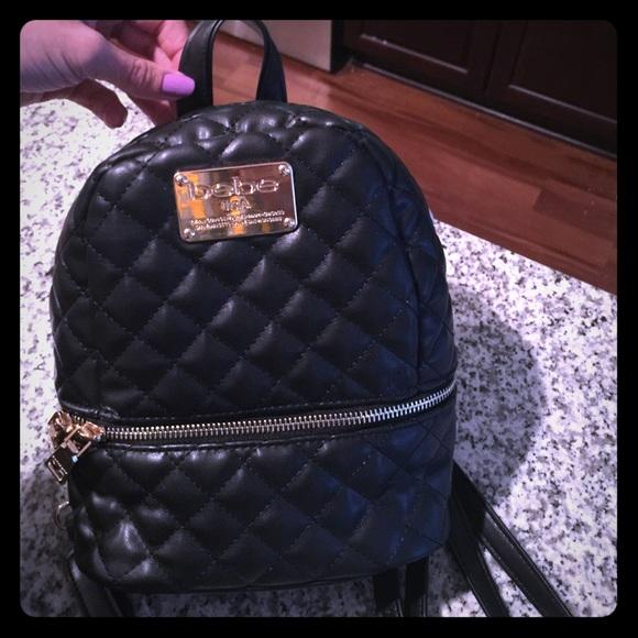 05e73101b523 Bebe black   gold mini backpack purse NWT