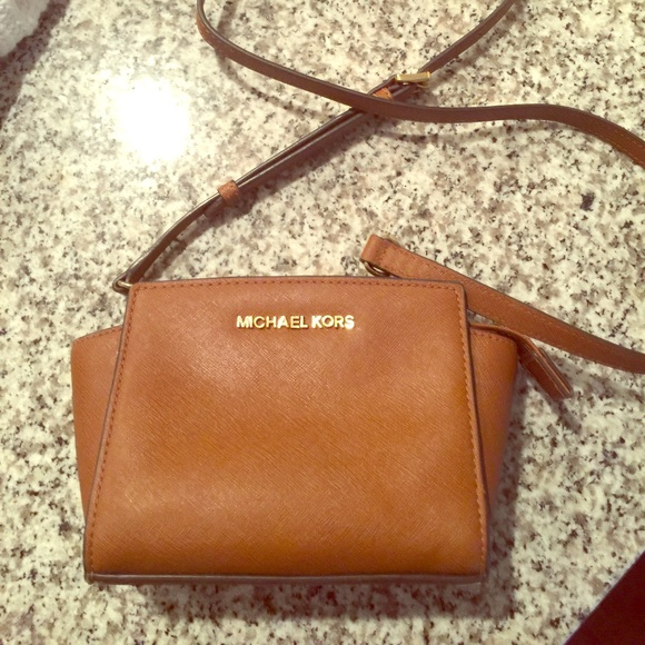 72a9dce08c78 Michael Kors Selma Mini Saffiano Leather Crossbody.  M 59125db2f0137d5236020d51. Other Bags ...