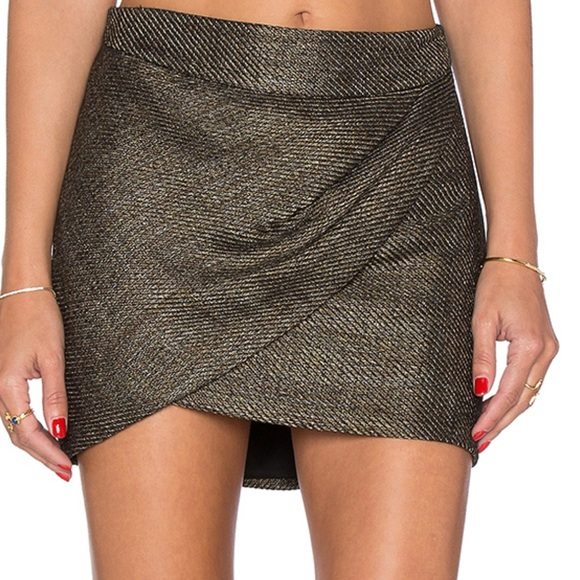 A knit mini skirt featuring a front tulip hem, a high-low silhouette, and an elasticized housraeg.gq: $7.