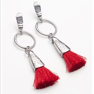 Free people hand to hold tassel earring