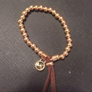 Michael Kors Jewelry - Gold Beaded MK Logo Bracelet w Leather Tassel