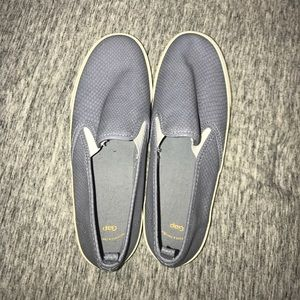 Navy, black, and blue slip on shoes.