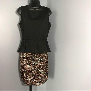 Dots Dresses & Skirts - Peplum animal print dress