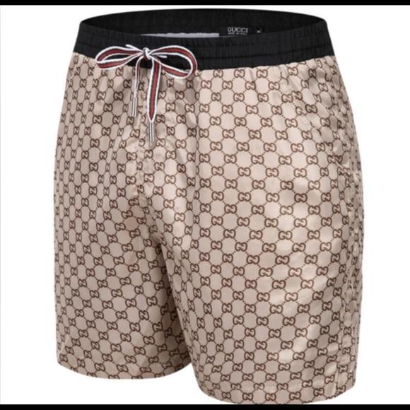 b5356d6e99 Gucci Swim | Mens Tan Gg Logo Shorts | Poshmark