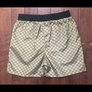 0b5162e22f5 Gucci Swim | Mens Tan Gg Logo Shorts | Poshmark