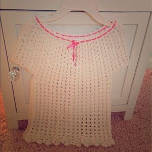 Hand knitted baby girl dress.