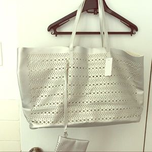 Saks Fifth Avenue Handbags - Saks NEW silver tote bag & detachable pouch.