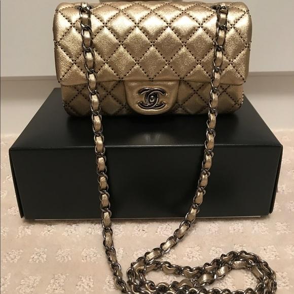 70c9d1f5a81c CHANEL Handbags - Chanel Gold Black iridescent new mini flap bag