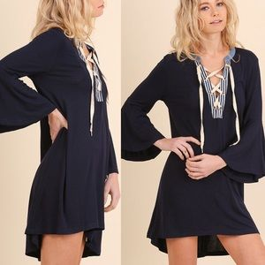 Pink Peplum Boutique Dresses & Skirts - 🆕 Hi low lace up navy tee dress with bell sleeves