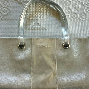 Clinique Handbags - Tote Bag with Silver Grommets and Goldtone Stripe