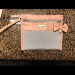 Viktor & Rolf Handbags - Authentic Viktor & Rolf baby pink cosm. bag clutch