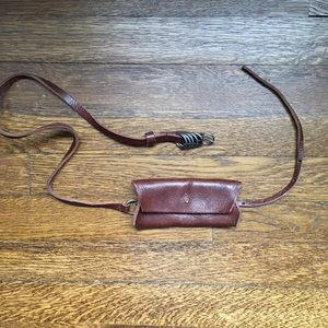 Humanoid leather belt with attached coin purse