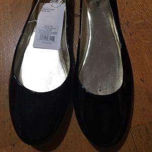 Black patent flat shoes.