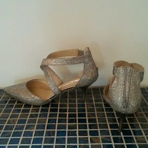 Dance all night in silver dress shoes. Worn 1x.