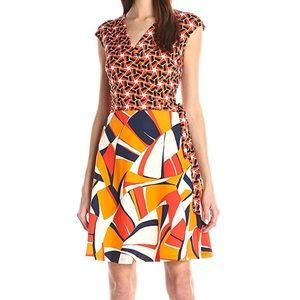 Taylor Dresses Dresses & Skirts - Never been worn Taylor Dresses wrap dress!