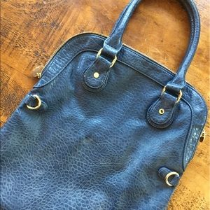 Deux Lux Blue faux leather print purse.