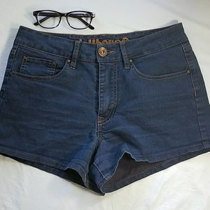 Dollhouse  high waist, dark wash, jean shorts.