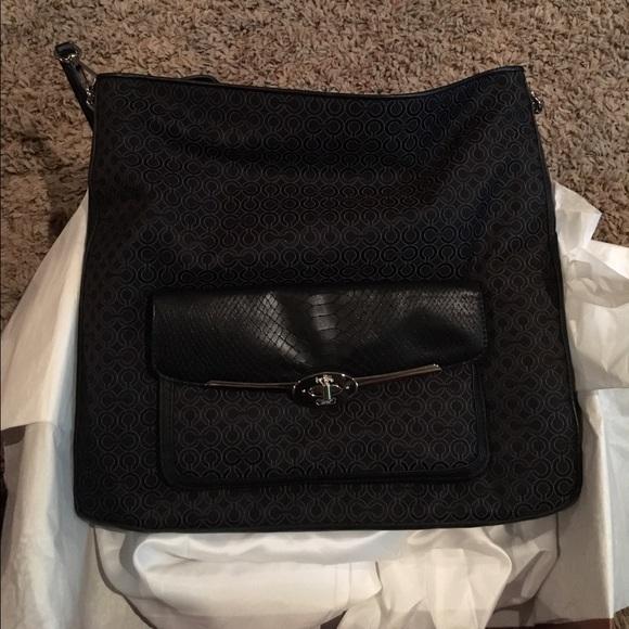 how to clean a cloth coach purse