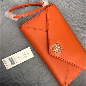 Tory Burch Handbags - Tory Burch orange wristlet
