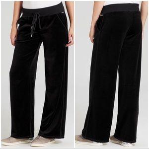 Black Michael Kors velour pants.