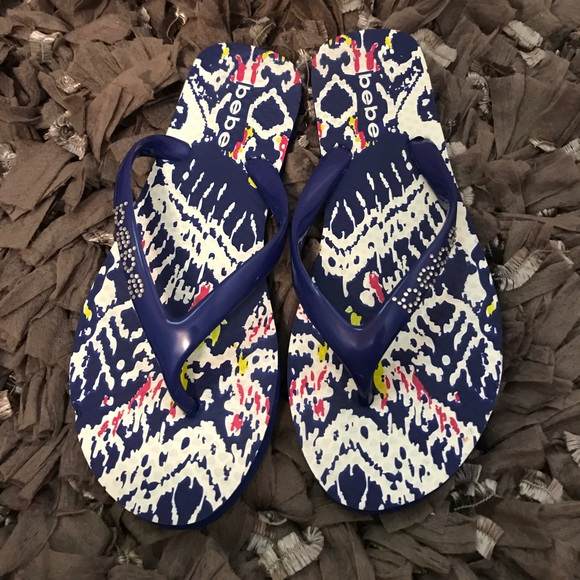 18426ff6cebc1b bebe Shoes - Blue Bebe flip flops with bling logo on thong