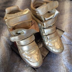 Gold Isabel Marant sneakers.
