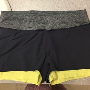 Gray workout shorts.