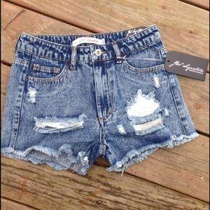 Pants - Distressed denim shorts