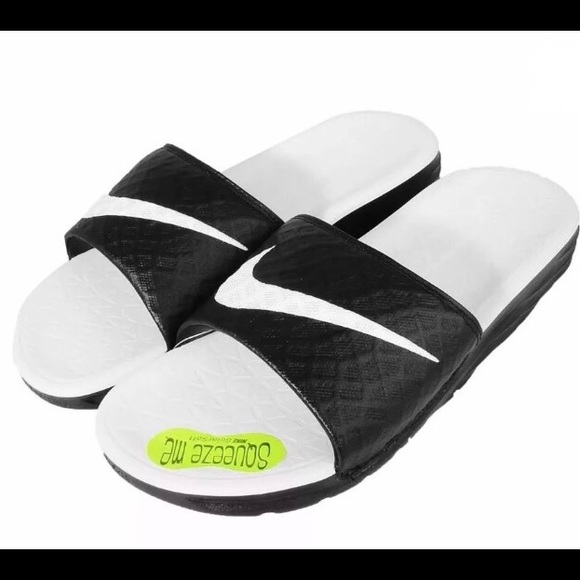 low priced 9b575 eaf5f New in box Women s NIKE BENASSI SOLARSOFT SLIDES